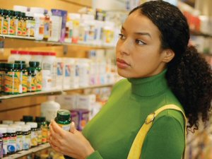 Woman Shopping in Supplement Aisle